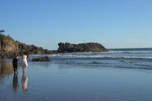 Lya and Antonia on the beach at Poneloya