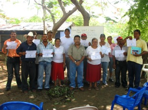 Presenting the participants in the community of Puerto Sandino with certificates of participation.