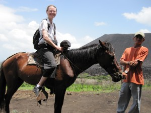 Mom riding one of the horses at the base of Cerro Negro