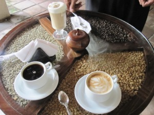 Our coffees on the beautiful wooden tables that are decorated with cleaned, dried, and roasted beans
