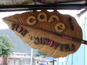 The wooden sign outside the SOPPEXCCA cafe in Jinotega