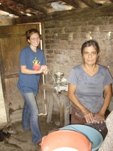 Making tortillas with Maria.  I'm grinding.  Maria grinds eight mill-fulls of corn a day for her large family.