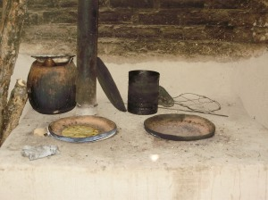 Many Nicaraguans, even in the city, cook over open fire.  This is a more effecient and healthy wood stove, as it burns less wood and has a chimney to carry the smoke outside.  The fire is underneath, and the two griddles are resting on open holes.  Pots are also put right on the open fire, or ontop of a griddle to simmer.