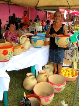 Doña Socorro displays her handmade pottery at a coop sponsored fair.